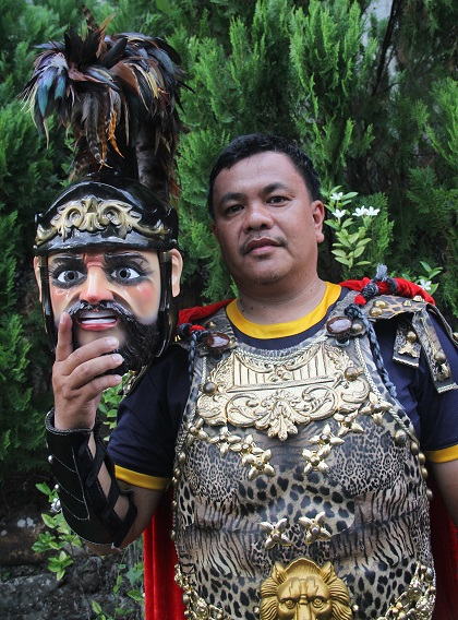 Glenn Deligero, an agricultural technologist and cook, is shown in photo wearing a traditional Moriones costume during his home province Marinduque's famous Holy Week festival. Photo by Rafael R. Zulueta, InterAksyon.com.